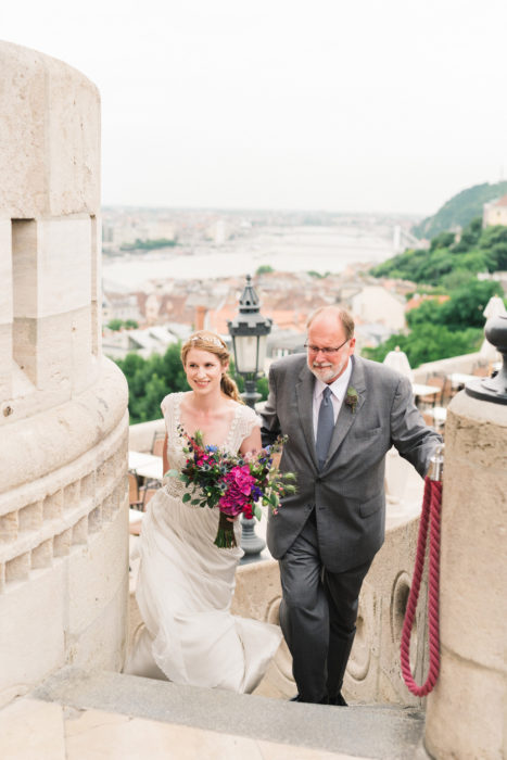 father walking bride to intimate ceremony budapest photographer